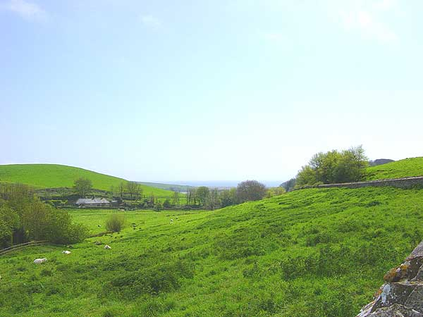 Abbotsbury - view from the bottom of Chapel Hill towards Abbotsbury Swannery, by Andrew Green